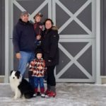 Brittney Livingston, Andrew Mazurka and their sons Travis (standing) and Emmett, at the entrance to the barn housing horses and artisanal chicken near Hillsburgh.