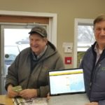 Larry Reynolds, left, and Lloyd Crowe were the first users to make a sale of corn using Grain Discovery's system.