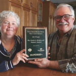 Bonnie Wilson and Doug Gray display the Mapleseed Pasture Award they recently won at the Beef Farmers of Ontario annual meeting.