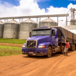 A truck driver prepares to unload soybeans in Brazil.
