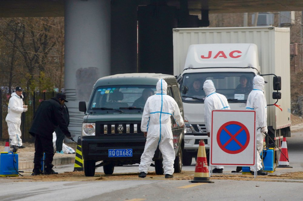 Workers in protective suits at a checkpoint near a farm where African swine fever was detected, in Fangshan district of Beijing, China Nov. 23, 2018. The disease has spread rapidly to several countries in Southeast Asia with more countries likely to be hit in the coming months.  Photo: Reuters/File