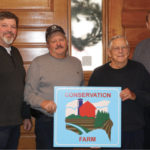 Brian Hyland, ESCIA president, left, Richard Paquette, his father Robert Paquette and Michael Dick representing Essex Region Conservation Authority were part of the presentation of the Conservation Farm Award to the Paquette family.