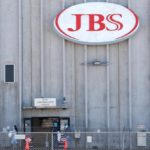 Employees walk around with face masks at the JBS USA meat packing plant at Greeley, Colorado on April 14, 2020. (File photo: Reuters/Shannon Stapleton)