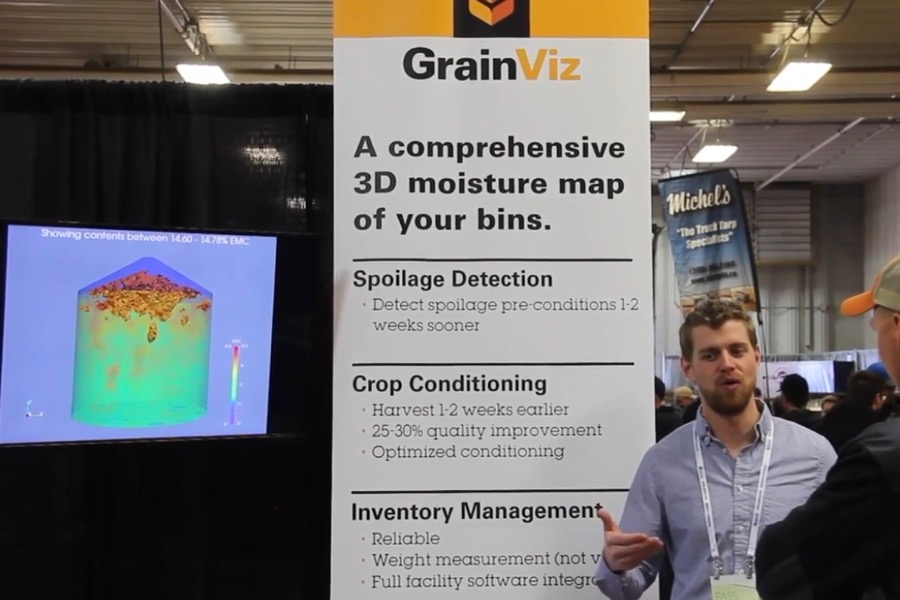 GrainViz engineer Braden Pierce explains the system to farmers at Ag Days at Brandon, Man. in 2018. (Screengrab from GFM/Greg Berg video)