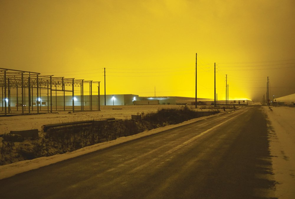 Highway 77, the highway along which many of the areas greenhouses are built north of Leamington, is illuminated at 7:30 p.m. in December 2020.