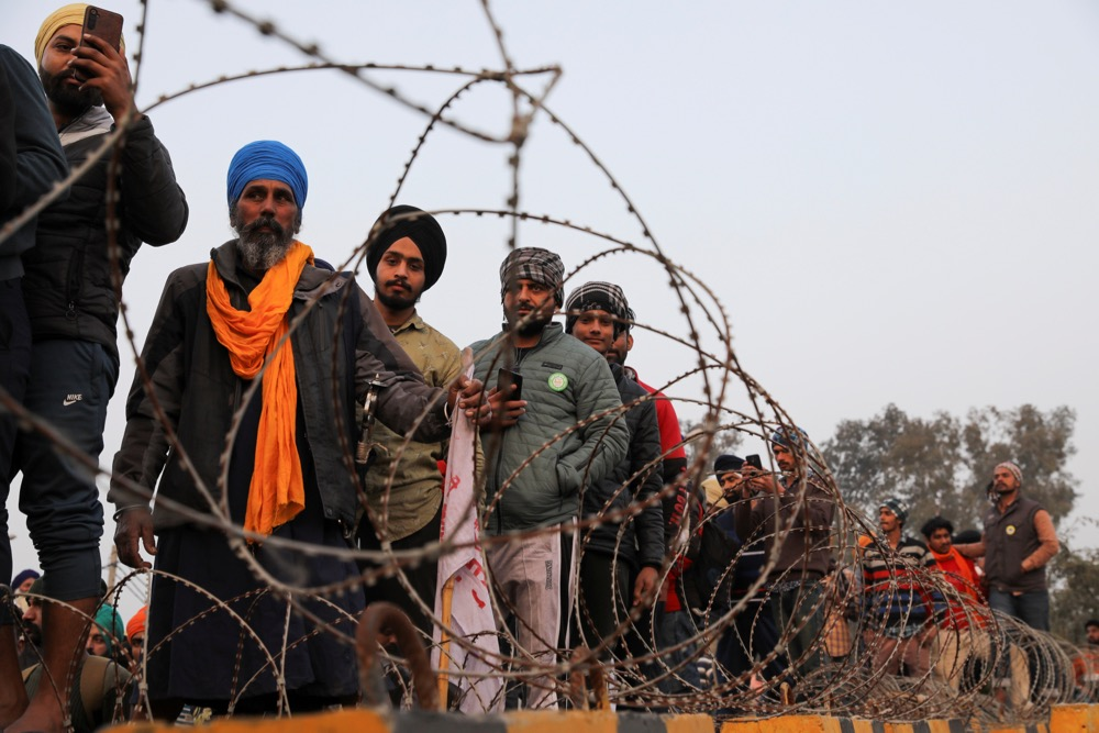 Farmers prepare for a rally against India's newly passed farm laws ahead of Republic Day at Singhu border near New Delhi on Jan. 25, 2021. (Photo: Reyters/Anushree Fadnavis)